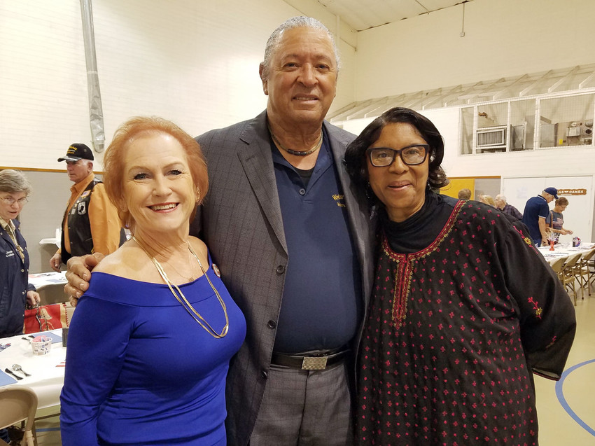 Dr. Richard Watkins (center), from Huntsville, who was a helicopter pilot during the Vietnam War, was the guest speaker for the annual Veterans Dinner in Bedias on Saturday.