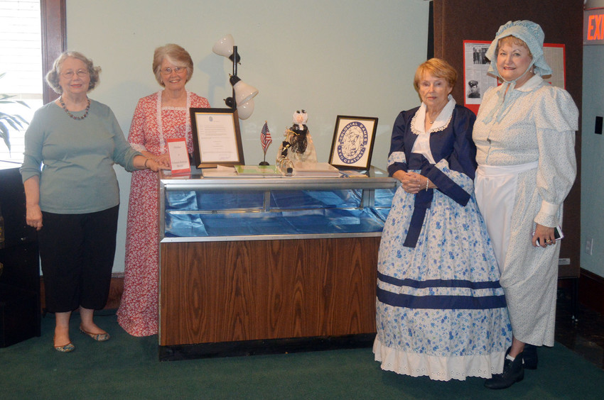 Members of the Robert Lawrence Chapter of the Colonial Dames of the Seventeenth Century pose with an exhibit recognizing October as Colonial Heritage Month. Pictured are (from left) Patsy Strawther, Maisie Temme, Bonne Hendrix and Nancy Page.