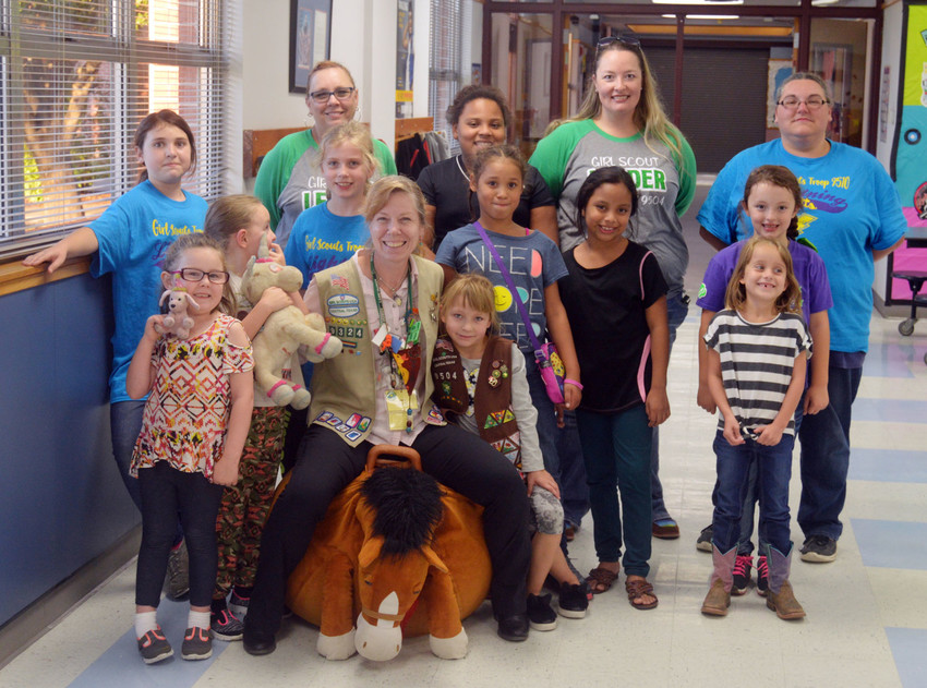 Member Development Executive for Girl Scouts in Bryan and College Station Ginny Ford (sitting) poses with prospective Scouts in Madisonville along with volunteers and troop leaders at an interest meeting at the Elementary School on Wednesday.