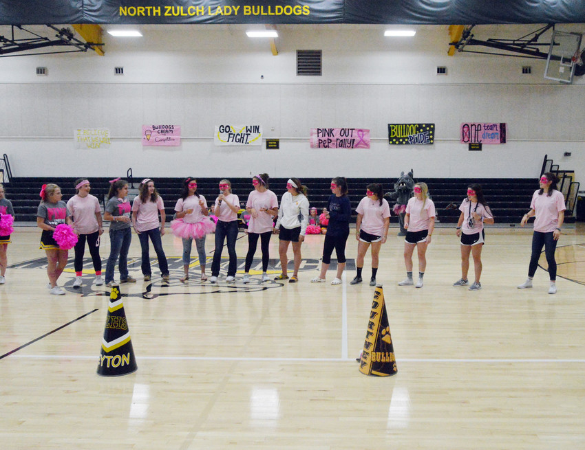 The North Zulch volleyball team stands before a wild crowd at a school pep rally preceding Tuesday's match against Iola.