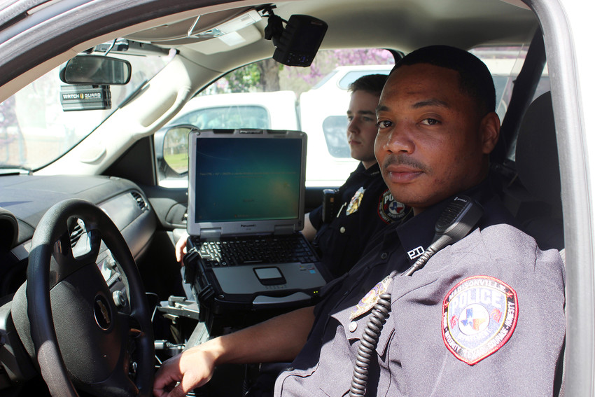 New Madisonville Police Officer Kerry Simmons rides with his training officer. Simmons became the latest officer to join the squad recently.