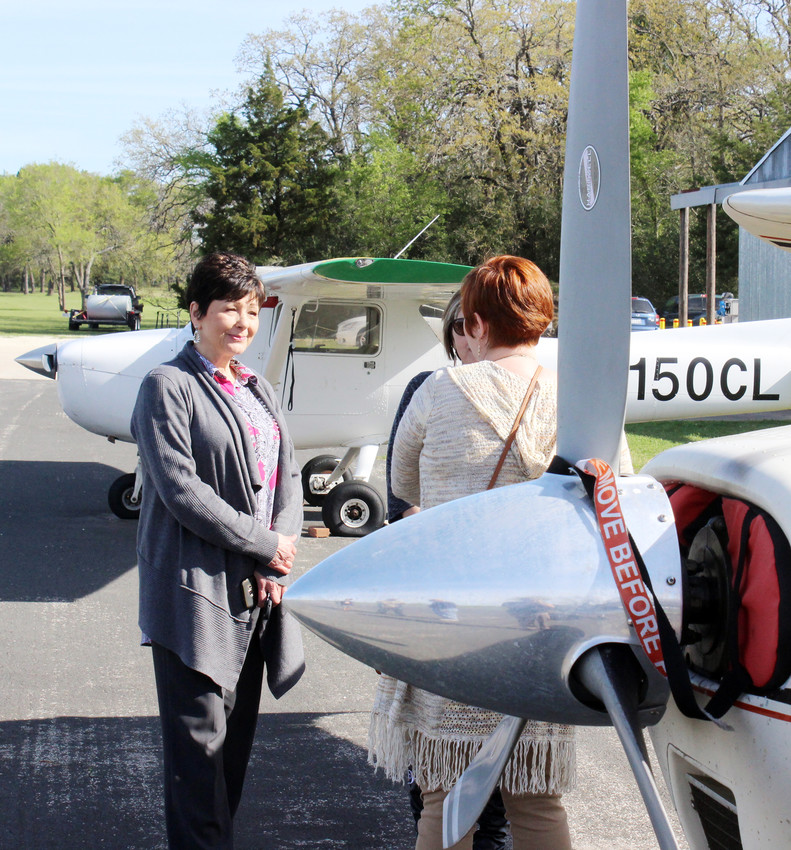 At an open house last week at the Madisonville Airport, Madison County Chamber of Commerce members April Fox, Liz Ward and Maurita Turner discuss the improvements at the airport.