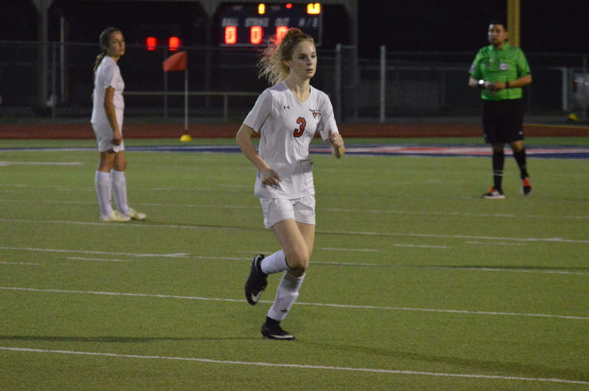 Brinna Simms of the Lady Mustangs leaves the field during a regular season game in Madisonville.