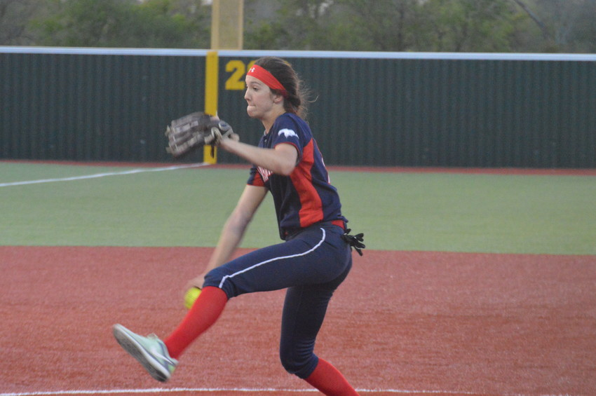 Madisonville's Riley Pittcock delivers a pitch to an opposing player during a Lady Mustangs hoe game last month.