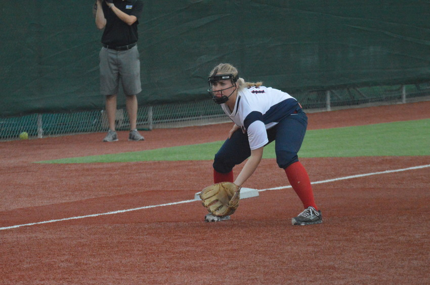 Madisonville's Kacelyn Jarrell readies herself for a play at third base in the rain during Tuesday's home contest against Fairfield.