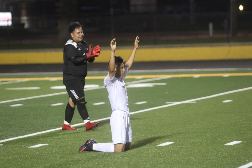 Madisonville's David Parras falls to his knees in triumph following Friday's 1-0 win over Brazosport in the Regional Quarterfinals in Sealy.