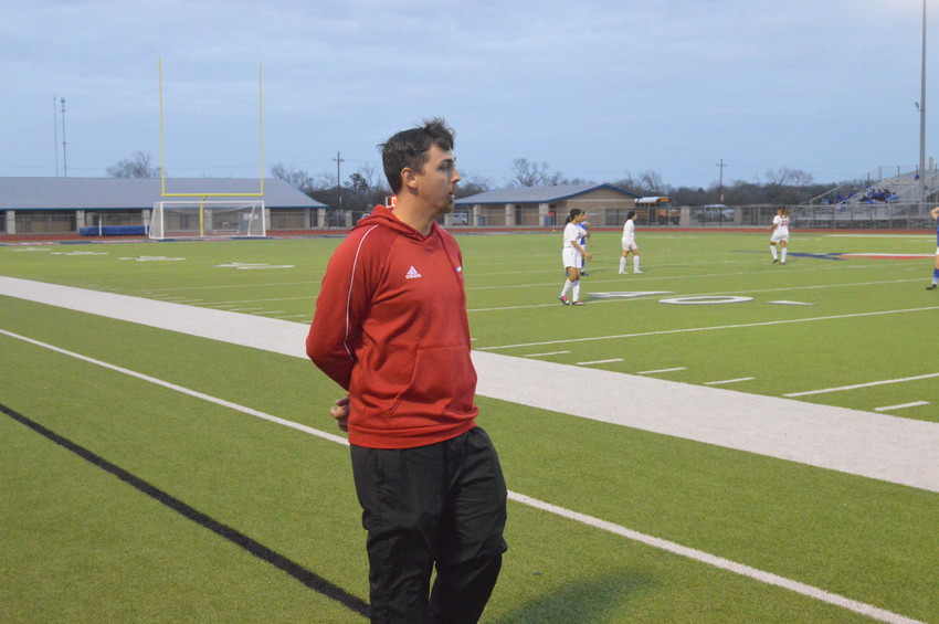 Madisonville women's soccer coach Travis Rasbeary patrols the sideline during a Lady Mustangs home game this season.