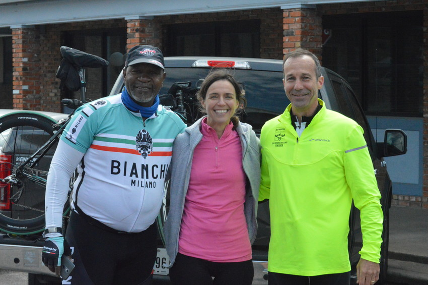 Tour de' Madisonville organizer Steven Green (left) poses with participants from The Woodlands Sol Labanca and Richard Thomas at the event on Saturday.