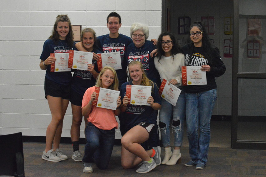 North Zulch FCCLA students pose with their certificates and Family and Consumer Science teacher Jane Dill at Thursday's monthly board meeting.