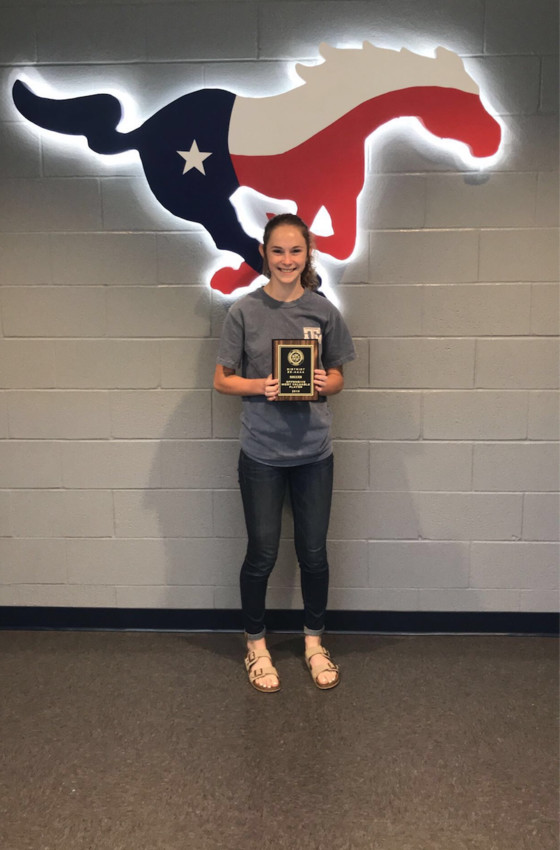 Madisonville's Brinna Sims poses with her plaque for the district's offensive MVP award.