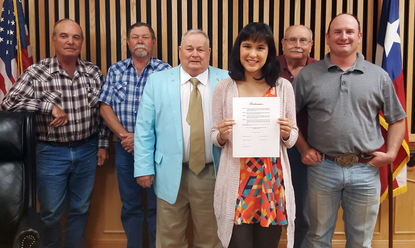 The Madison County Commissioners' Court presents Amanda Gomez of the Brazos Valley Sexual Assault Resource Center with a proclamation naming April as Sexual Assault Awareness and Prevention Month on Monday.