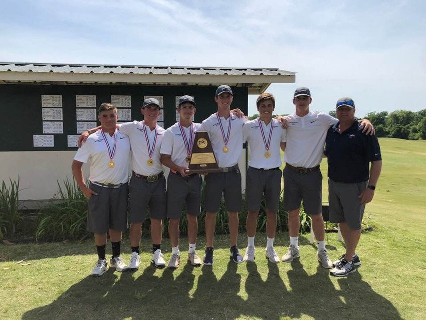 The regional champion Madisonville golf team poses together with the Region III 4A trophy following their first-place finish in Huntsville last week.
