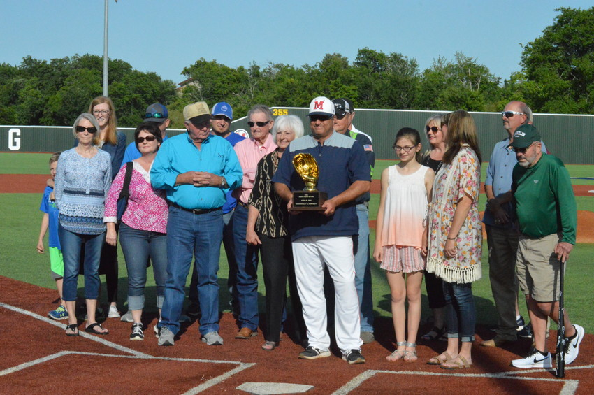 Coach Keith Sitton, who won his 300th career game this season, is honored at home plate with his family on Friday before the senior ceremonies.