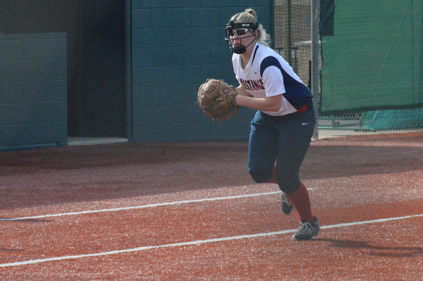 Madisonville senior softball player Kacelyn Jarrell prepares to fire the ball to first base during an exhibition matchup against Teague last month.