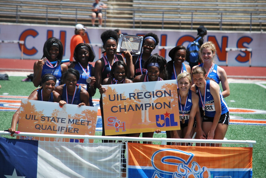 The middle four track stars Mimi Holiday, Kenndie Moffett, Monique Berry and Garlanesha Gilbert pose together after their first place finish in the Women's 4x100 relay to advance to state.