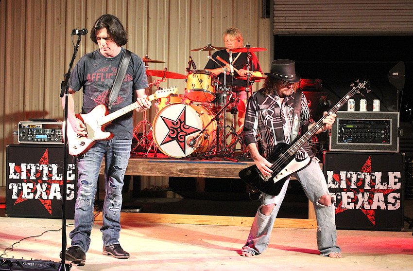 Little Texas, who had a string of hits in the 90s on the country music charts, entertains the people of Madisonville attending the 78th annual MSCA Steak Dinner on Saturday.