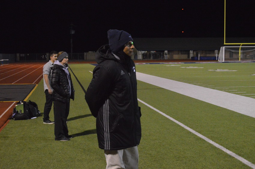 Madisonville men's soccer coach Baltazar Reyes patrols the sidelines during a home game this season.