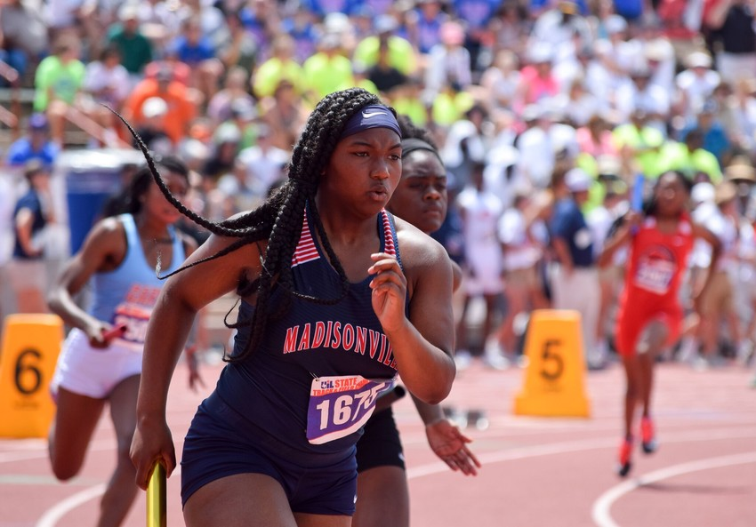 Madisonville state qualifier Mitzi Holiday competes at Austin, where she and her teammates finished sixth in the 4x100-meter relay.