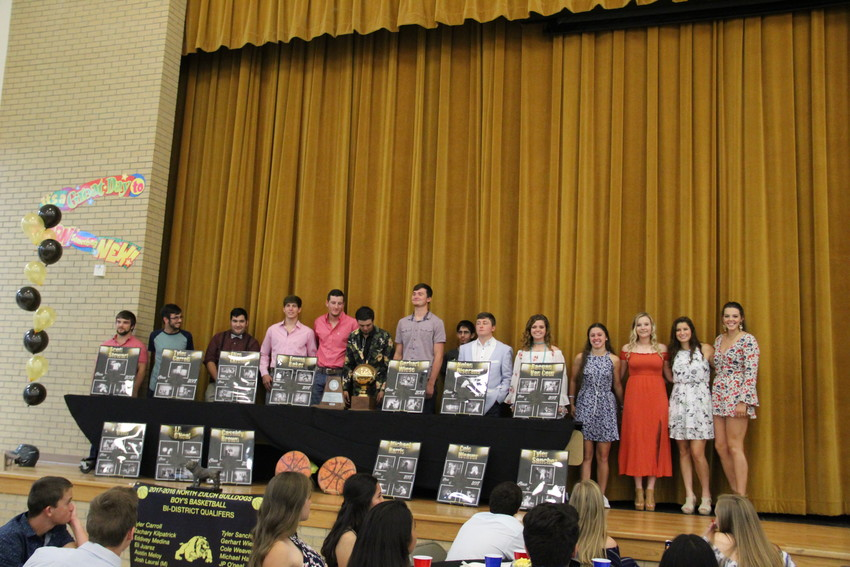 North Zulch Bulldog senior athletes pose together on the stage at the annual North Zulch sports banquet.