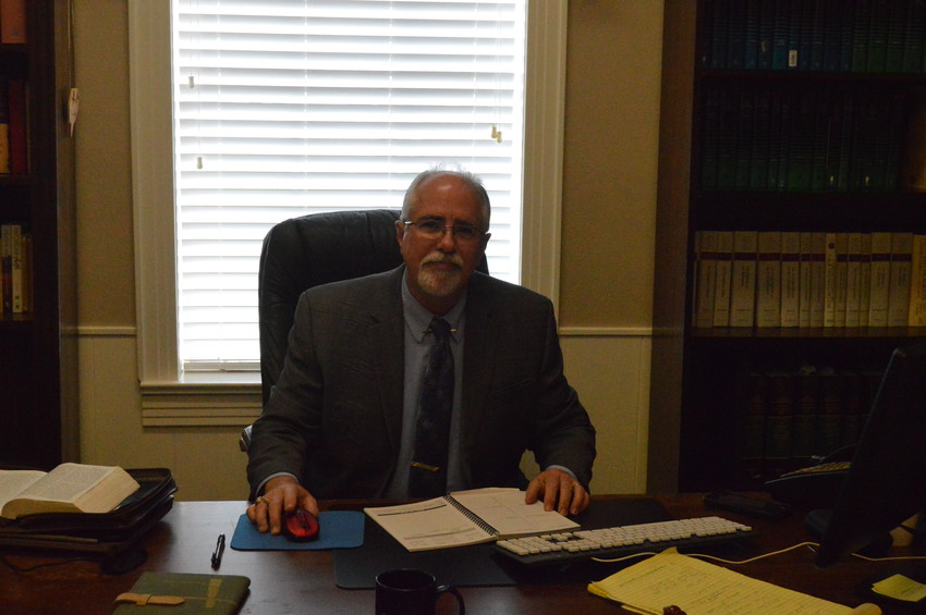 Pastor Jim Jackson sits in his new office inside First United Methodist Church in Madisonville.