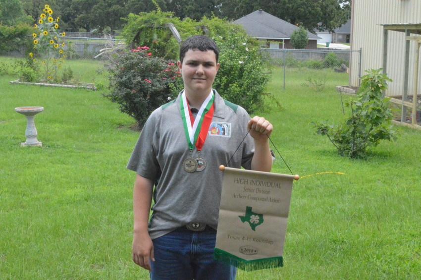 Madison County 4-H participant Zachary Rebstock took first place in the Compound Aided Archery Contest at Texas A&M earlier this month.