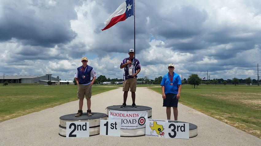 Zachary Rebstock (right) stands on the podium of the Texas State Archery Outdoor Championships.