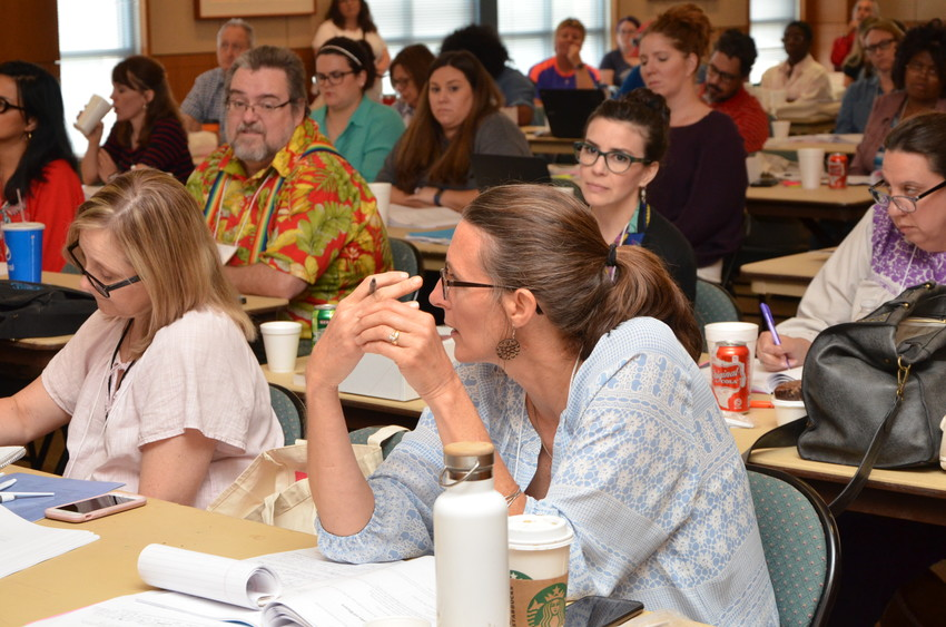 "North Zulch ISD teacher Joan Osth discusses American literature with fellow educators at ""Teaching the American Literary Tradition"" sponsored by Humanities Texas last month in San Antonio."