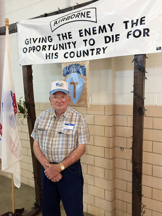 Korean War Veteran Billy Van Davis poses with a banner at a Military function earlier this year.