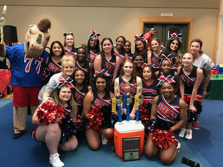 Madisonville High School cheerleaders pose together after a successful week at the Universal Cheerleading Association Camp at the Great Wolf Lodge in Grapevine.