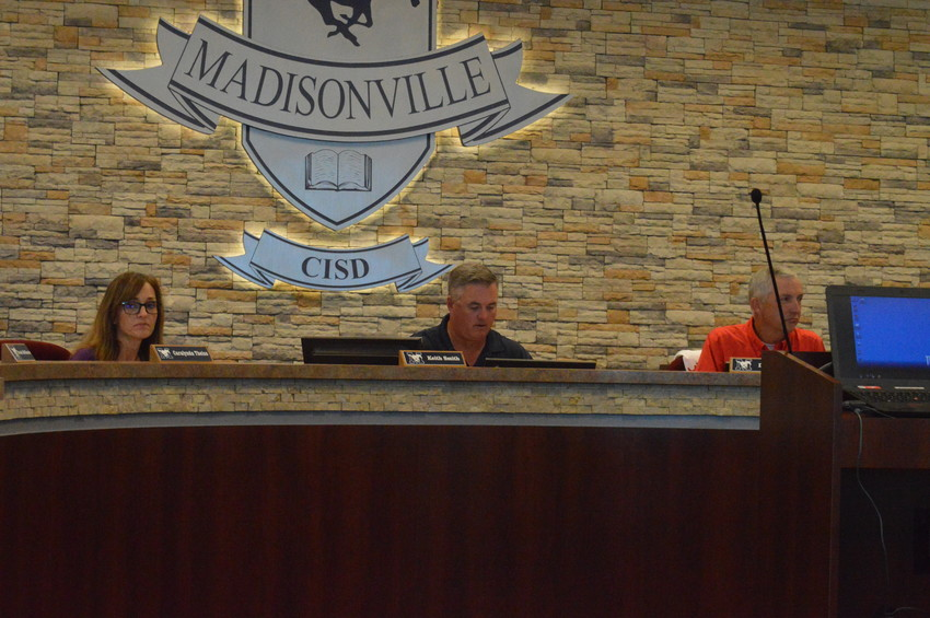 Madisonville CISD Superintendent Keith Smith leads Monday's board meeting for the month of August.