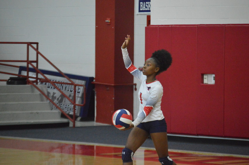 Madisonville's Kia Moffett prepares to deliver a serve during last Tuesday's win over North Zulch at MHS.