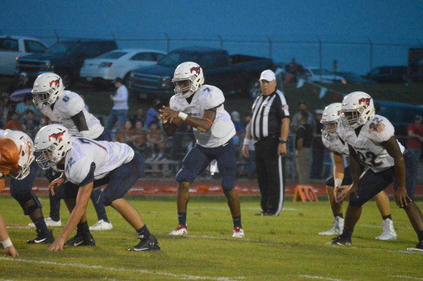 Quarterback Tyrese Brown and running backs Aaron Nellums (6) and Uriel Willis, who combined for over 400 rushing yards on Friday, await the snap in Caldwell.