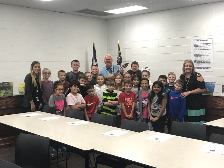 Children's book author Steve Swinburne poses with North Zulch students at the elementary campus on Tuesday.