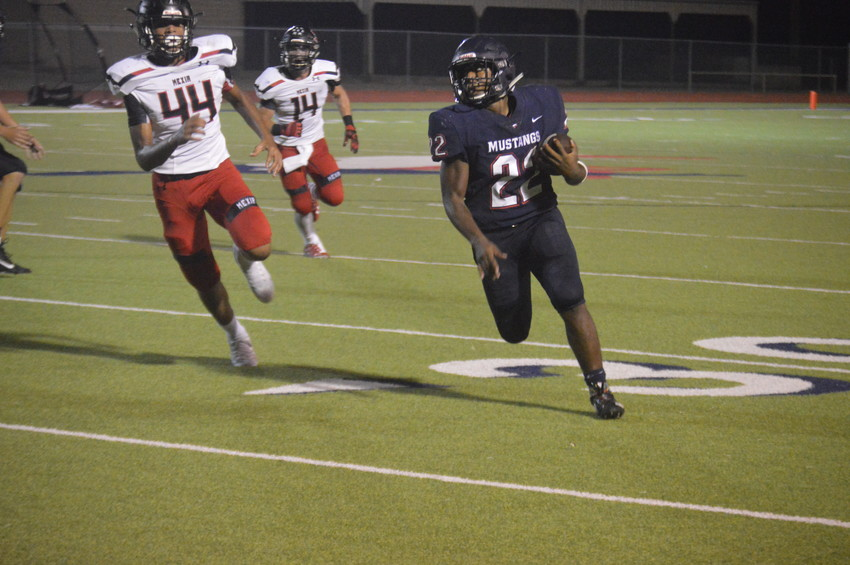 Madisonville's Uriel Willis (22) finds the corner against the Black Cats in the second quarter of Friday night's win at MHS.