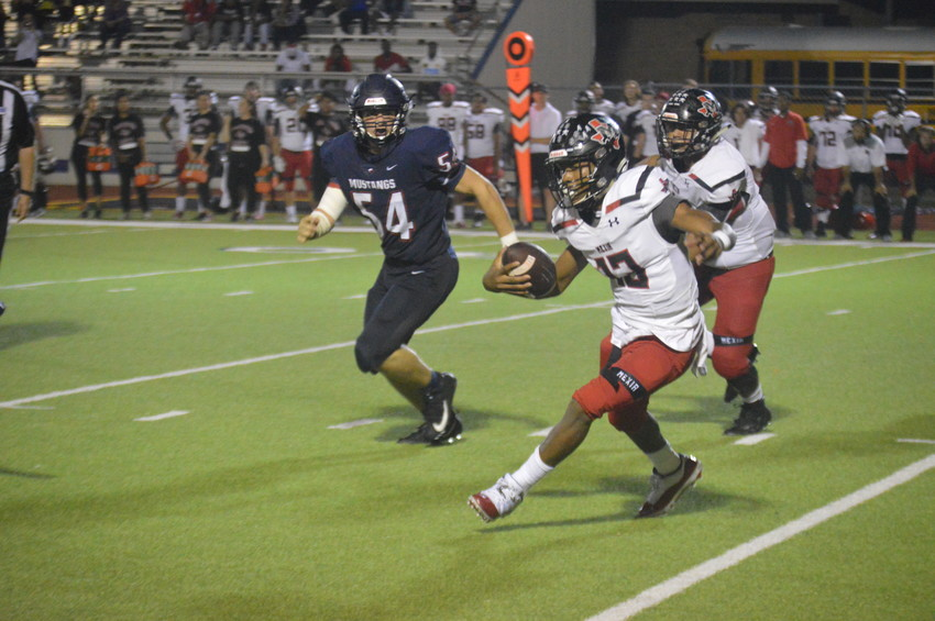 Madisonville's Micheil Harrell (54), who recorded two game-saving tackles late in the fourth quarter on Friday, chases down Mexia quarterback Jaden Proctor in the fourth quarter.