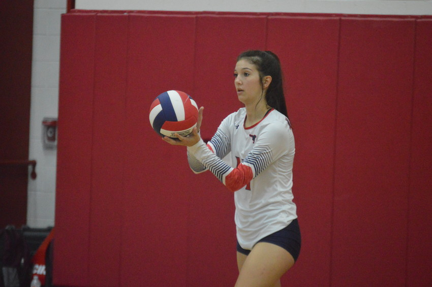 Madisonville's Riley Pittcock prepares to deliver a serve during last Tuesday's victory over Palestine at MHS.