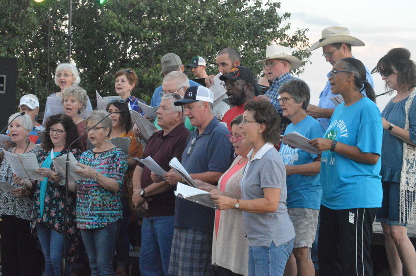 Members of the First Baptist Church Choir kick off the entertainment for National Night Out at Lake Madison on Tuesday.