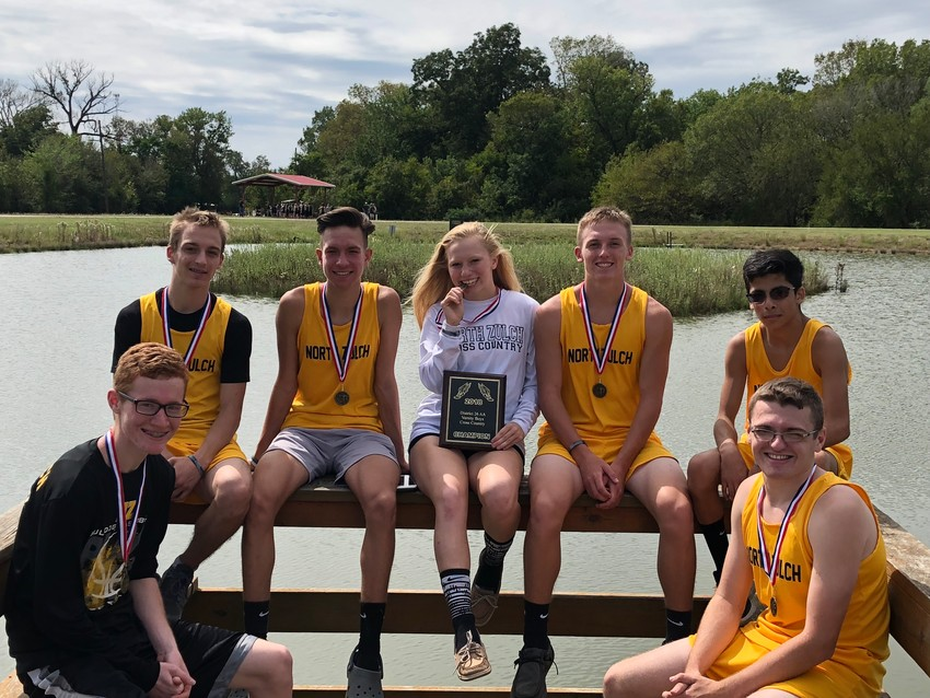 North Zulch High School back-to-back Cross Country District Champions pose together following their meet on Thursday. Pictured are (from left) Peyton Wolfe, Holden Green, Landon Thiess, Tessah Haggard, Kaleb Holder, Michael Kirk and James Pryor.
