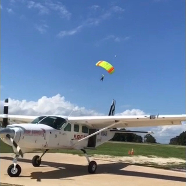 Jeanette Davis parachutes down after skydiving.