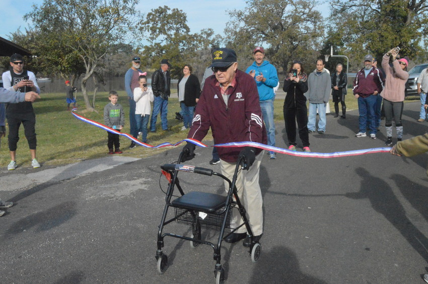 Local WWII Veteran and Purple Heart Recipient Alfred Birdwell completes his birthday goal of walking a mile to raise money for Veterans at Lake Madison Park on Saturday morning. He turned 100 years old the following day.