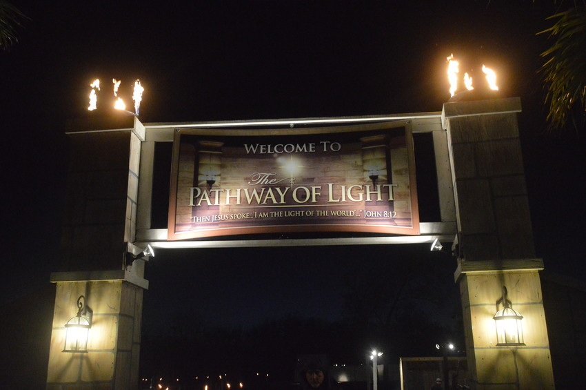 A sign welcomes guests into the Pathway of Light during the 11th annual event in 2017.
