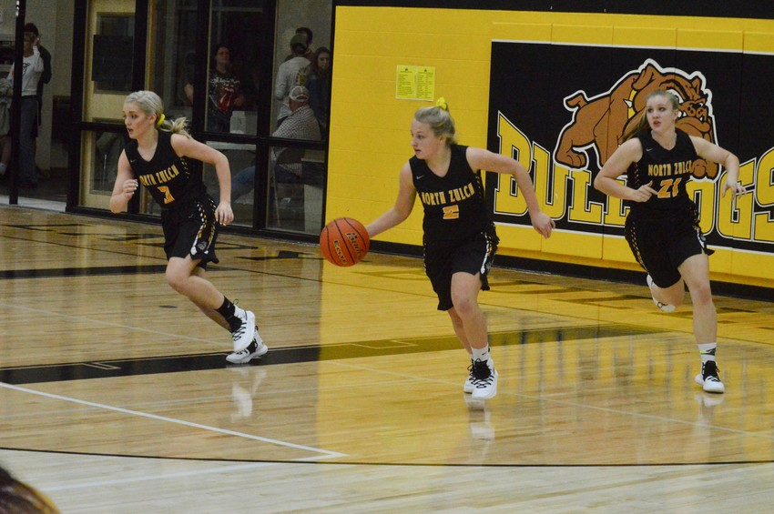 North Zulch sophomore Katelyn Crocker (middle) handles the ball during a Lady Bulldogs home game.