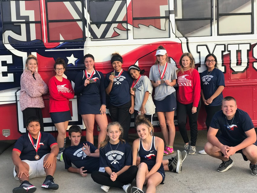 Members of the Madisonville tennis team pose with their medals after a tournament in Killeen on Nov. 15.
