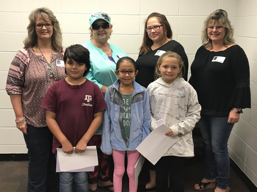 NZISD Pre-K to 4th Grade Domestic Violence Bookmark Contest Winners: Back row, L-R:  DVTF members Bunny Unterreiner, Sharon Phelps, Consuelo Martinez, and Shelly Butts.   Front row:  Winners Gracie Thompson – 1st Place, Dayana Medina – 2nd Place, and Alexis Mooney – 3rd Place North Zulch Elementary School.