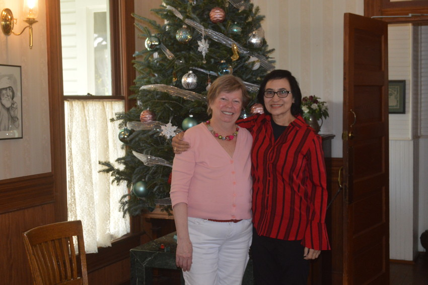 Susan Warmuth (left) poses with new Woodbine owner Shamshad Zaidi at the hotel on Monday.