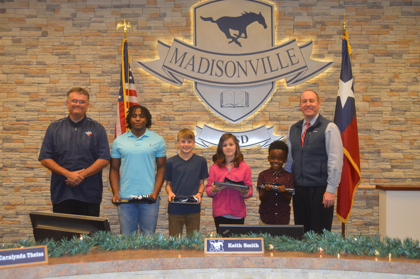 MCISD Students of the Month (from left) Uriel Willis (High School), Jeremiah Brown (Jr. High), Jaylynn Warren (Intermediate) and Jaydence Whaley (Elementary) pose with Dr. Keith West (left) and Board Member Dale Hurst.