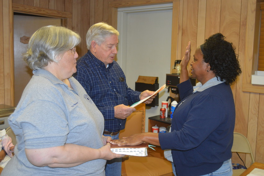 Tony Leago swears in new Midway Mayor Brenda Ford at the Midway Fire Department on Monday.