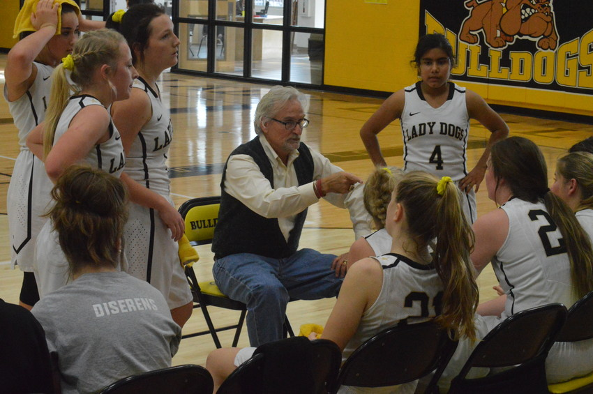 Coach Michael Stenseth discusses strategy with his players during a break in the action of a game at NZHS.