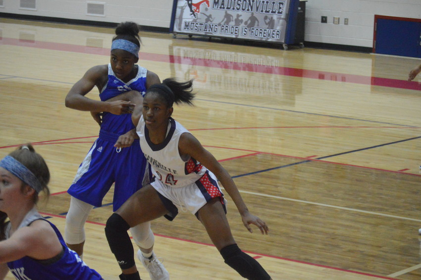 Madisonville's Khyra Cooper posts up her defender in the paint during Friday night's game at MHS.