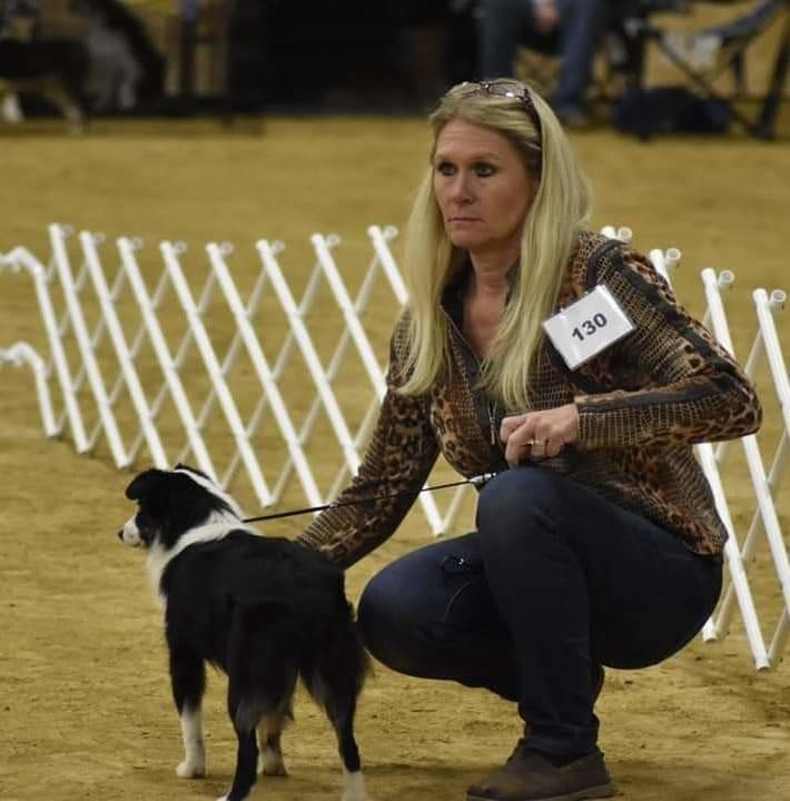 "Kelly Enloe sits with Miniature Aussie ""Tank"" at the ASDR Invitational show in Las Vegas."